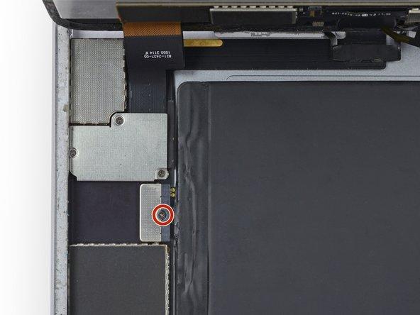 移除单个固定电池端子与逻辑板连接的 1.8 mm Phillips螺丝。