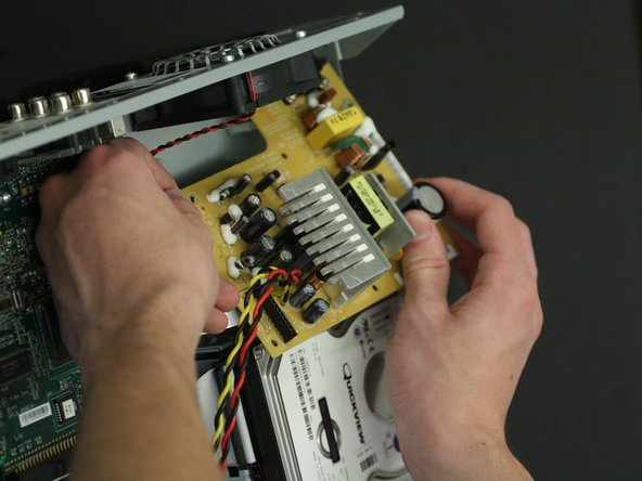 Image 1/2: Do not touch any circuit elements or capacitors on the power supply, as they may hold a charge after the unit has been shut off.