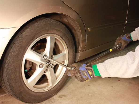 Using a torque wrench, tighten the lug nuts on each wheel to 80 ft-lbs.