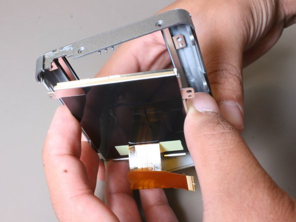Remove the LCD screen from the remaining casing of the camera.