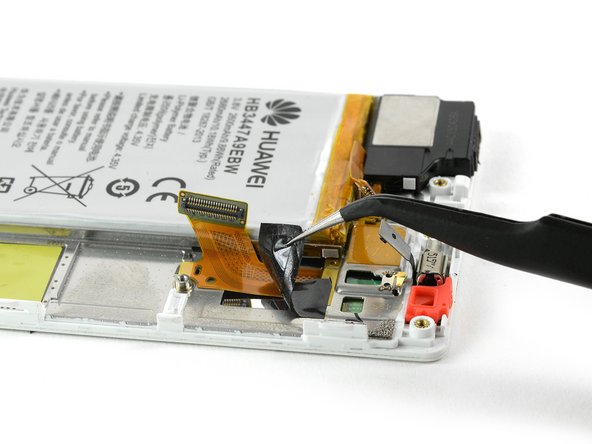 Remove the adhesive tape which is covering the display flex cable.