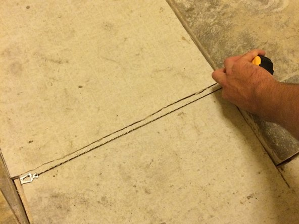 These lines will act as your guide when setting the tile into the mortar.