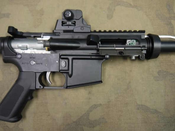 You can now slide the upper receiver  forward. It may take some pulling to get it to move.