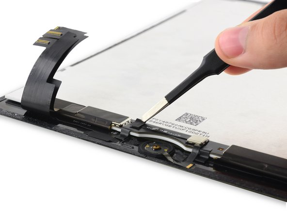 Peel up the tape covering the Home Button ZIF connector.