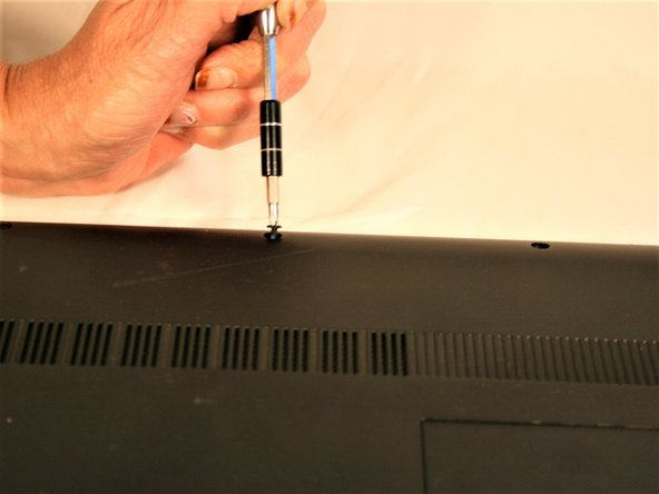 Locate and remove the 3 screws securing the outer cover of the laptop