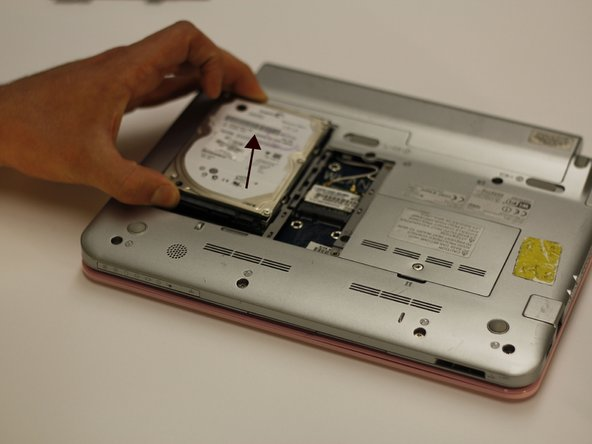 Image 2/2: This will free the hard drive from its original location.