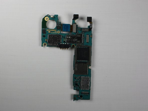 Image 3/3: Pull the motherboard from the frame and lay it on a flat surface.