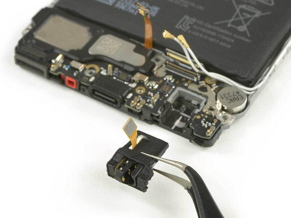 The headphone jack might be a little bit sticky. In case you're having trouble removing it, use an iOpener to loosen the adhesive.