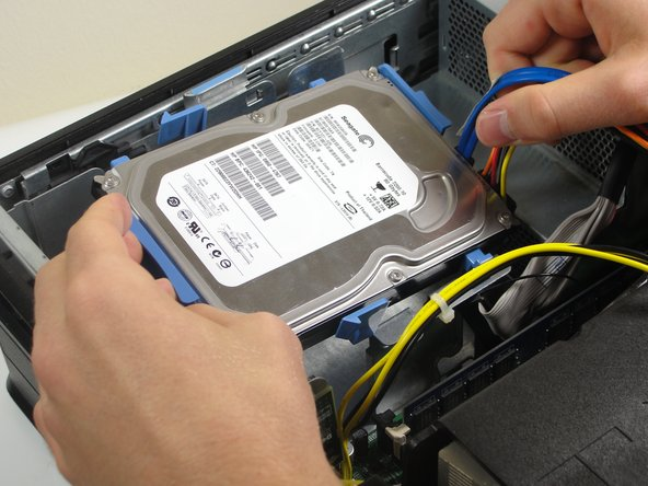 Lift the hard drive from the case after it comes loose.
