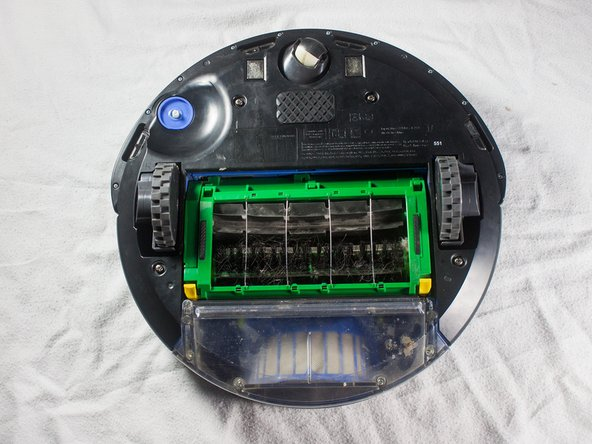 Rotate the Roomba upside-down so the bottom is facing towards you.