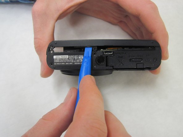 Use the plastic opening tool to pry open the back cover off.