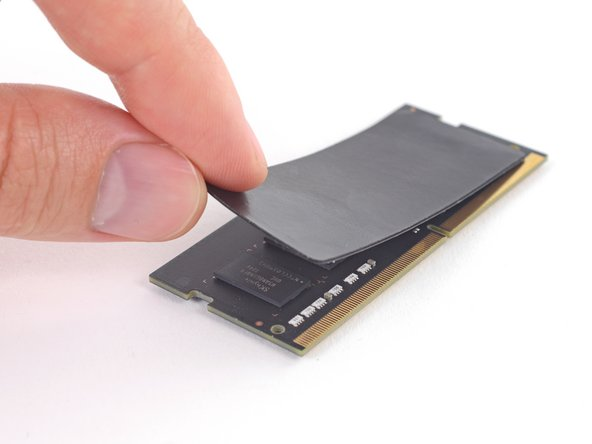 Peel off and transfer the thermal pad from the original RAM stick to your replacement RAM before you install it in the lower slot.