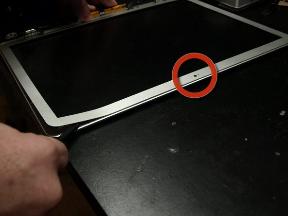"""Avoid placing the spudger within 20mm (3/4"""") of the built in camera.  There is no adhesive in this location, and the spudger could damage the camera."""