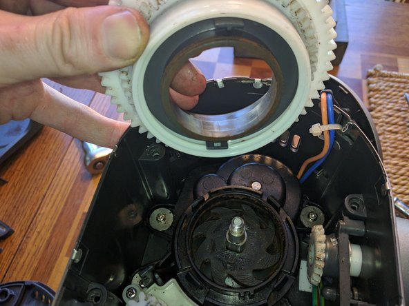 It's critical that the alignment be preserved when removing the gear assembly.  The small gear in the picture is an encoder. Its purpose is to track the position of the grind adjustment level so it can be displayed on the digital readout. If it gets out of alignment the display will end up reading wrong.