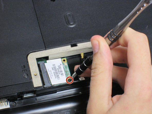 Image 3/3: Remove the 3mm screw holding the Wi-Fi module using a Phillips #0 screwdriver.