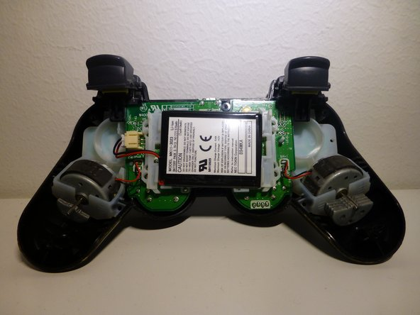 Once the cover is off, the controller should look like this. Follow the red and black wire(s) from the battery to the connector.