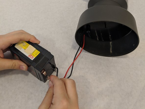 Carefully detach  the negative wire from the battery terminal first.