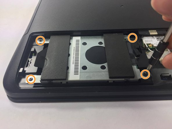 Locate and remove the 4 screws holding the hard drive down at each corner using a PH000 Philips head.