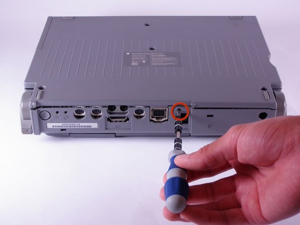 Use a T8 torx screwdriver to remove the 6.8mm long screw above and to the right of the modem jack.