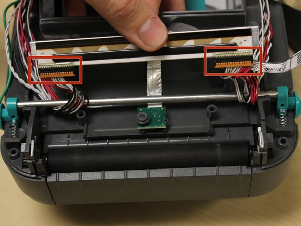 Gently remove the two cables on each end of the printhead.
