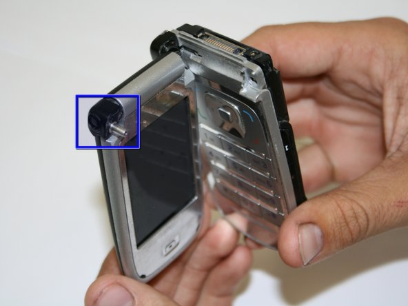 Image 2/2: Once screw are removed, the phone will separate easily into two pieces connected by a flexible wire strip.
