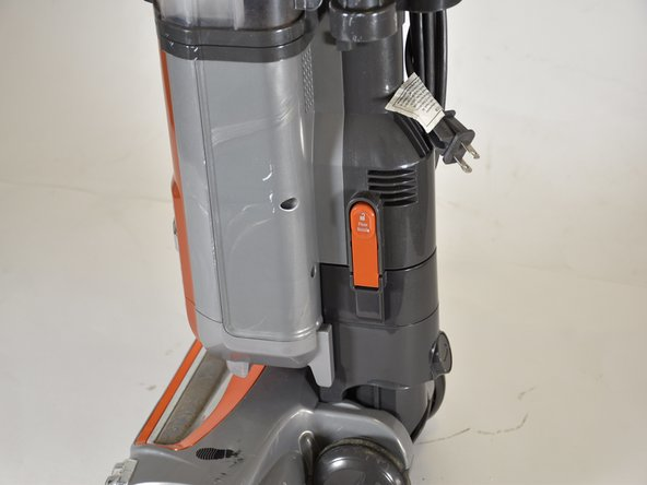 "Look towards the side of the vacuum for the orange ""Floor Nozzle"" button."