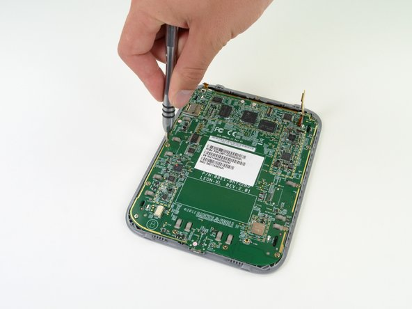 A mere eleven T5 Torx screws, one ZIF connector, and the display cable connector hold the motherboard in place.