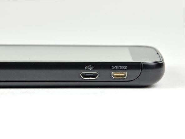 Image 2/2: One of the most highly touted features of the Atrix is its [http://www.motorola.com/Consumers/US-EN/Consumer-Product-and-Services/Mobile+Phone+Accessories/Docking-Stations/Atrix-Laptop-Dock-US-EN?localeId=33|connectivity]. This is accomplished through side-by-side micro USB and micro HDMI ports.
