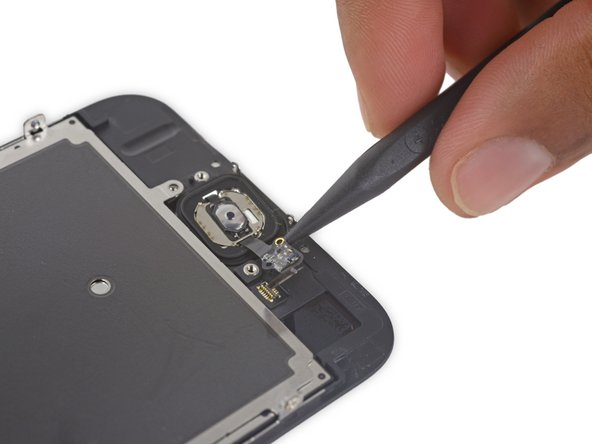 Use the pointed tip of a spudger to pry the home button flex cable off the back of the display panel.