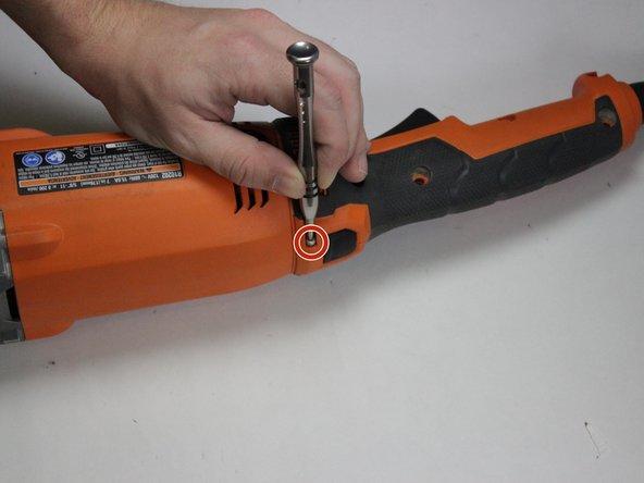 Using a Torx T10 screwdriver, remove the M3 x 10mm  screw.