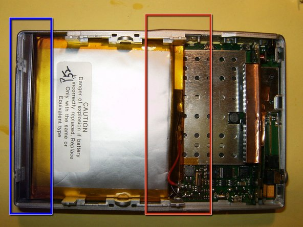 Image 2/3: Here is the reason for loosening the logic board. Push it lightly below the level of the battery.