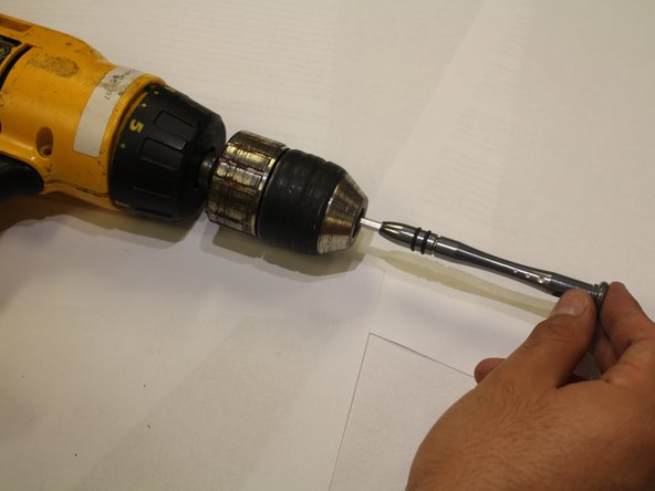 The chuck screw is reverse threaded, which means you will need to unscrew it counterclockwise.