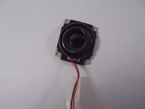 Carefully flip the speaker over and replace or clean the needed parts.