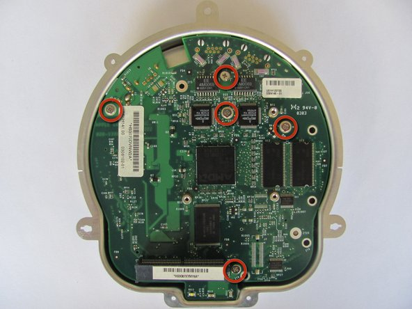 Image 1/2: Lift and separate the motherboard from the bottom metal casing.
