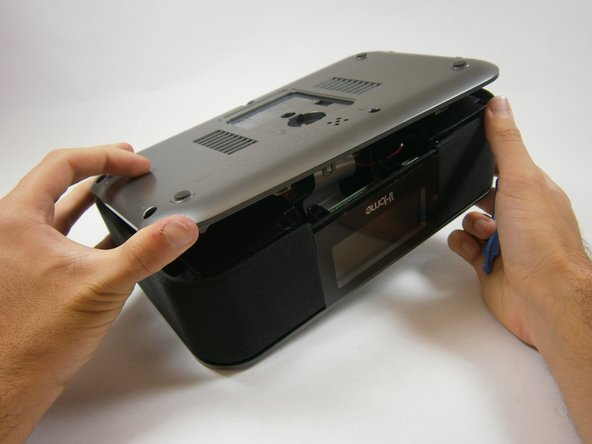 Insert a plastic opening tool between the edge of the bottom cover and the main body.