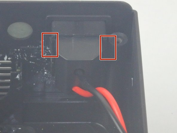 Using the small plastic splunger, press in on the two latches on the sides of the power supply switch, then push it out of the case.
