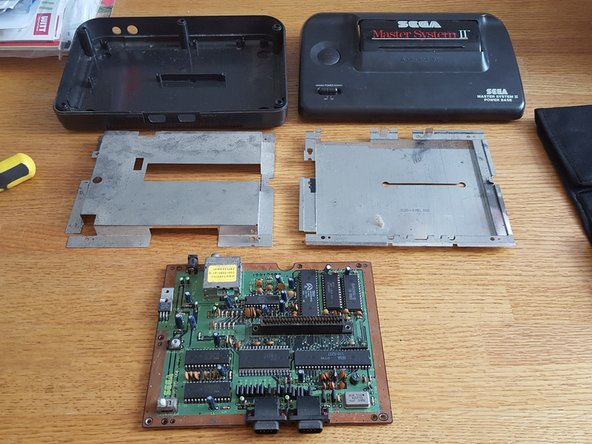 Image 1/1: Once you've got the replacement board, just follow this guide in reverse order,