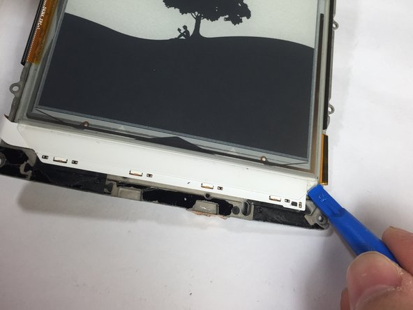 The screen itself is glued to the mid-frame. If your replacement screen does not include the mid-frame, heat the screen with an iOpener and gently pry it from the mid-frame with a blue plastic opening tool.