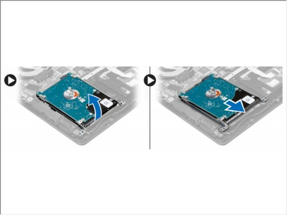 Lift the hard drive assembly in an upward direction to release it from its compartment on the computer. Remove the hard drive from the computer.