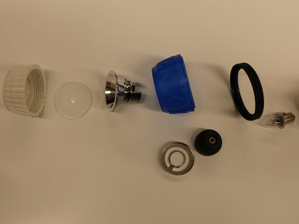 The complete light bulb component disassembly.