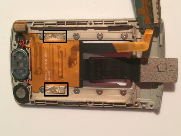 There are adhesives on each side of the plate, sticking to the ribbon cable, pry carefully.