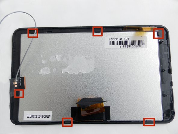 Insert the plastic opening tool between the screen and the case to release the clasps holding the screen.
