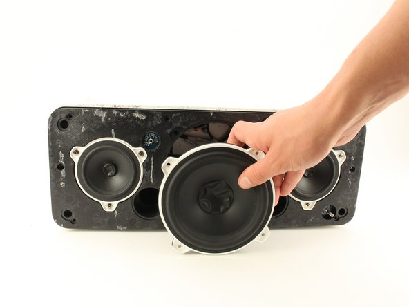 Remove the speaker slowly from its socket with your hands.