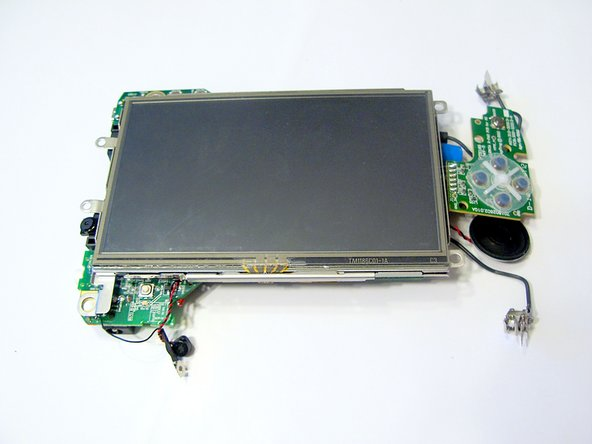 Lift the screen from the motherboard by pushing the board out from the three metal tabs.