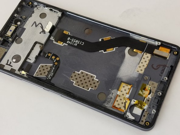 After carefully pulling the port and vibration module, it should now be free from the phone and can be replaced.