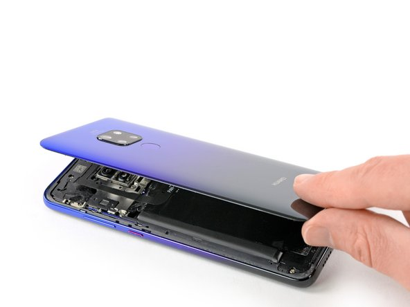 Carefully fold the back cover to the right side of the phone assembly. Avoid tension to the fingerprint cable during this procedure.
