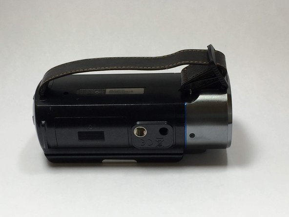 Locate the battery slot on the underside of the camcorder.