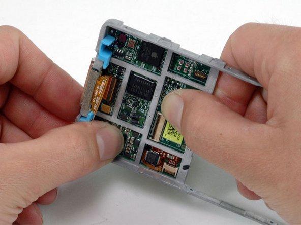 Carefully push the logic board away from the metal framework.