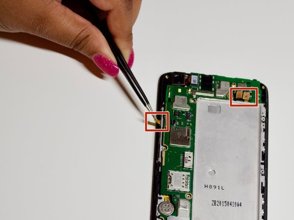 Lift up the connectors with tweezers to disconnect them from the motherboard.