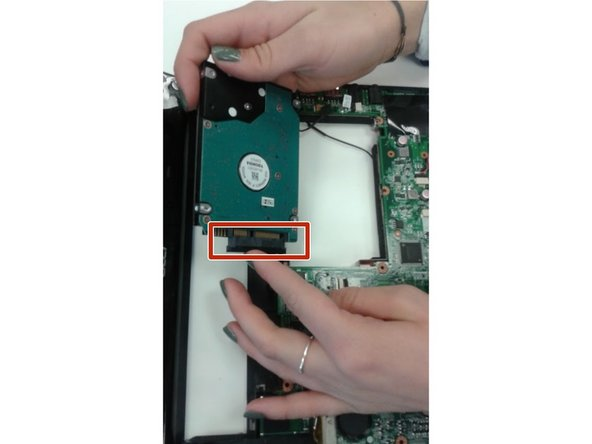 Image 2/3: Disconnect the hard drive FPC cable from the mainboard.